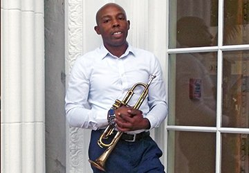 Music Teacher Toots His Horn about UMO